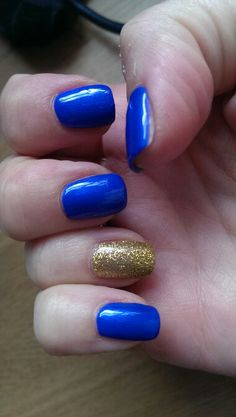 My bright blue and  glitter gold accent nails for a wedding to match my outfit :)