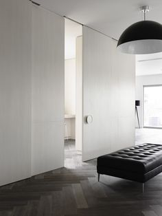 Sliding door * Interior of spacious apartment in the suburb of Toorak by Melbourne architect Ella Leoncio for Chamberlain Javens Architects. #Black #White