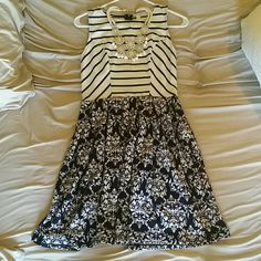 Black & White Patterned Dress Worn Once. In excellent used condition. Looks brand new. No stains, holes, etc. Top is black & white striped. Bottom is a black & white damask print. This dress is super comfortable and can easily be dressed up or down. Fits sizes 2-4. Xhilaration Dresses