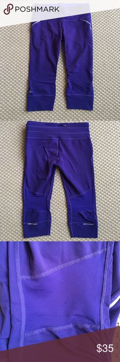 """Athleta Relay Capris Comfortable and flattering Athleta workout capris in """"Amalfi Blue,"""" which look purple to me! Back zip pocket and never ending drawstring waist. Size medium petite, so inseam is 18.5 inches for us petite folks. Material is 87% nylon supplex and 12% Lycra. They were worn only a few times and are in great condition. One tiny pull on the mesh behind the right lower leg (as seen in pic). Athleta Pants Capris"""