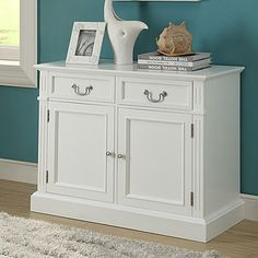 This cabinet will provide ample storage space with two drawers & two doors White wood finish will match with any room décor Clean lines Assembly required