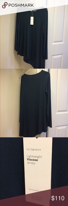 """NWT Eileen Fisher Asymmetrical Hem Ballet neck top NWT Eileen Fisher Asymmetrical Hem Ballet Neck top. Color is called fir. I would say more a blue/green color. Short side 26"""" front 28"""" back. Longer side 33"""" front  35"""" back. 95 % Viscose, 5% spandex. Super soft and comfy. Smoke and pet free home. Eileen Fisher Tops Tunics"""