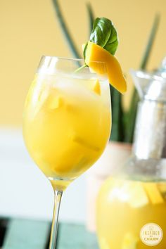 Pineapple, Mango, and Basil Sangria #cocktail #entertaining @inspiredbycharm