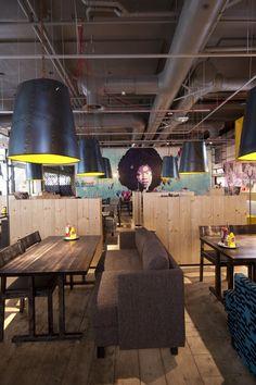 Amerikka Design Office have re-designed the interior of a Chico's restaurant in Espoo, Finland.