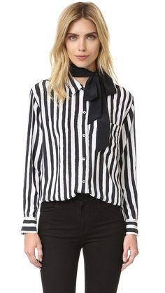 Painterly stripes accent this relaxed silk Kate Moss x Equipment blouse. Optional solid tie. Fold-over collar and button placket. Patch breast pocket. Long sleeves and button cuffs.