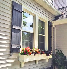 Edie, from Ohio, was very kind to send us her pictures of the new shutters she got from Architectural Depot. & is using one of our most popular shutters, the& Size Four Board Joined Shutters along with these Shutter Hardware& … Continue reading → Exterior Paint Colors, Exterior House Colors, Paint Colors For Home, Exterior Design, Cottage Exterior, House Shutters, Exterior Shutters, Homes With Shutters, Navy Shutters