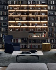 """Wall System in cenere oak, inner grids th. 1/2"""" mat lacquered piombo and built-in led lamps. Tribeca coffee table, piombo metal painted and top in glossy calacatta oro marble. Onda pouf in 1403 ocra Persia removable velvet."""