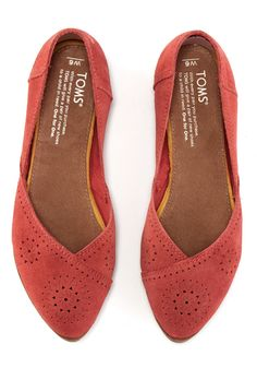 These delicately perforated suede flats are easy to slip on and perfect for casual days that call for a pop of color and flair.