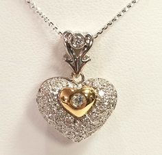 18kt two tone gold diamond heart with 14kt diamond cut cable chain.