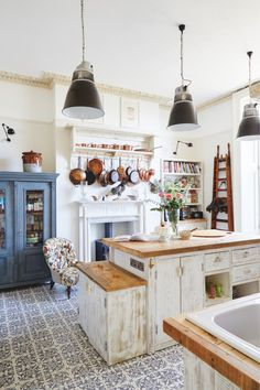 *A mix of all eras* 'Mixing styles and eras is all about being confident and   thinking, 'Yes, this will work'', says interior designer Louise Convert. A   local firm made the kitchen units in her kitchen from recycled scaffolding   boards, while the vintage ladder is from AG Hendy & Co. The old copper pans   have been collected from eBay and the cabinet is a vintage French piece.   Image: Brent Darby