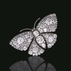 AN EXQUISITE ANTIQUE DIAMOND BUTTERFLY BROOCH  The old mine, old European and pear-shaped diamond body set en tremblant, extending similarly-set diamond wings, and single-cut diamond antennae, mounted in silver and gold, (with concealed hoop for suspension), circa 1850