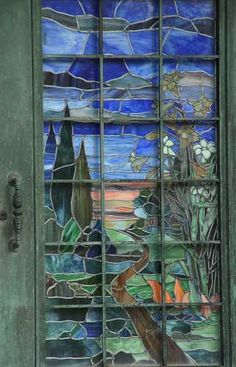 Stained glass has been a creative means of expression for many, many years.  These Tiffany style doors beckon passers by to enter and see what lies within. Paula Mitchell Bentley