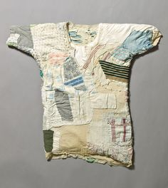 More patch than shirt, this garment was owned and repaired by Despina, a Greek immigrant living in Adelaide. Her husband  was a fruiterer and they lived in North Adelaide. They gave the shirt, along with a few other garments, to a neighbour on their return to Greece. It was then given to Lois Densham. The shirt is an example of the 'mend and make do' policy of 1940s.  Photographed by Michal Kluvanek