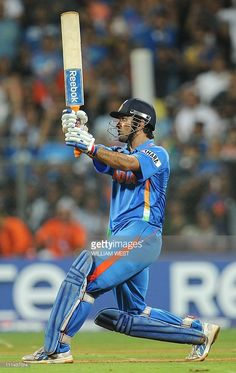 Indian captain Mahendra Singh Dhoni hits a six to give India victory over Sri Lanka in the ICC Cricket World Cup 2011 final played at The Wankhede Stadium in Mumbai on April 2, 2011. India beat Sri Lanka by six wickets. AFP PHOTO/William WEST