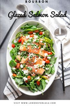This bourbon glazed salmon is what you call a gourmet salad!  A piquant bourbon glaze helps make a tender, flavorful salmon that tops a crisp, fresh salad.  A simple vinaigrette is all the dressing you need! #salmon #bourbon #fresh #salad #healthyfood via @Lemonsforlulu