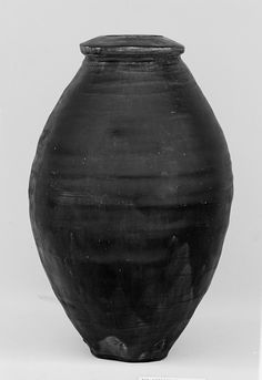 Jar: Period: Edo period (1615–1868) Date: late 18th century Culture: Japan Medium: Pottery covered with glaze (Kyoto ware) Dimensions: H. 12 in. (30.5 cm); W. 7 in. (17.8 cm)