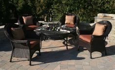 The Lochmoor Collection 4-Person All Weather Wicker/Cast Aluminum Patio Furniture Conversation Set With Drink Table . $2229.72