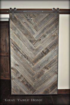 This DIY Herringbone Barn Door was built using reclaimed weathered barn wood.