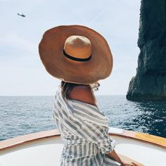 The perfect summer picture! Love the summer hat. I found a similar here: http://asos.do/yVHZFX