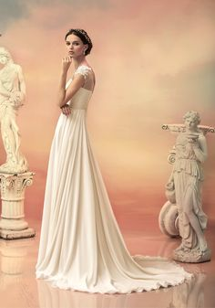 "Sheath is a modern, curve-hugging style in simple and sleek, and contours the body from top to bottom. From Papilio ""HELLAS"" bridal collection - www.papilioboutique.com"