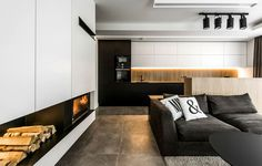 Black and White with Wooden Accents Apartment by Rimartus - InteriorZine