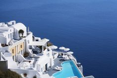 Katikies Hotel in Santorini  is perched on the Caldera cliffs, 300 feet above the waters of the Aegean