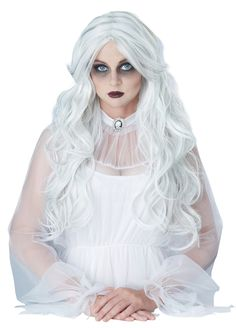 Delight in the terror you bring in this ghastly white wig. - Long, wavy strands of grey streaked throughout white locks. Synthetic fibres. Could be used for a ghostly bride or a stunning lady vampire costume – the options are vast! #yyc #calgary #costume #supernatural #ghost #synthetichair