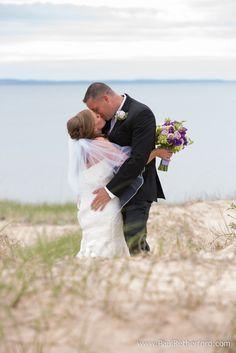 beach bride groom kiss photo