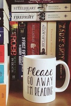 """Please go away, I'm reading."" Need we say more? Love this funny mug for book lovers by Bookworm Boutique on Redbubble."