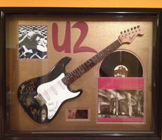 Fender guitar signed by U2 in display case rare