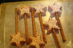 rice crispy treats + sprinkles + pretzel sticks = fun party food!    MAGIC WANDS :D
