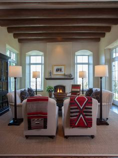 Native American blankets can add color and pattern to a neutral room, and make it seem relaxed. Love