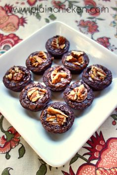 Turtle Brownie Bites #recipe I did it the easy way--just used turtle brownie mix. Mini muffin tin, caramel dollop on top, pecan on that.