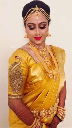 Golden vibes only! Surabhi looks mesmerizing for her muhurtam. Makeup and hairstyle by Vejetha for Swank Studio. Red lips. Nose rings. Maang tikka. South Indian bride. Eye makeup. Bridal jewelry. Bridal hair. Silk sari. Bridal Saree Blouse Design. Indian Bridal Makeup. Indian Bride. Gold Jewellery. Statement Blouse. Tamil bride. Telugu bride. Kannada bride. Hindu bride. Malayalee bride. Find us at https://www.facebook.com/SwankStudioBangalore