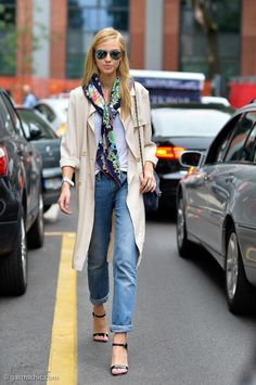 40 Amazing Baggy Jeans Outfit Ideas - a lightweight trench coat worn with a colorful silk scarf, cuffed baggy jeans, and ankle strap sandals