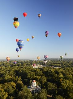 Hot air balloons soaring over Longwood in Natchez, MS during the annual Great…