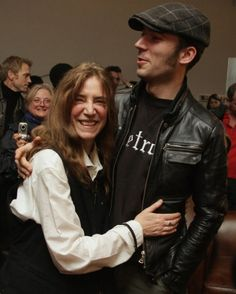 Patti Smith embraces her son Jackson at the Fondation Cartier in Paris, France on March 27, 2008.