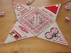 amazing embroidery...folds up into a pyramid shape...very cleaver design