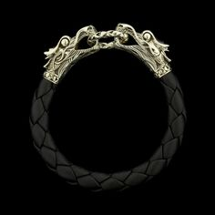 We love the details in this John Hardy sterling silver black leather naga bracelet
