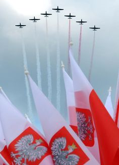 Polish Air Force TS 11 Iskra form contrails in Poland's national colors as they fly over the country's national flags during a military parade marking Polish Armed Forces Day, in Warsaw, Poland, Friday, Aug. 15, 2014. Poland is holding its biggest military parade in years with tanks and soldiers moving through central Warsaw and military aircraft flying overhead. The parade comes on the August 15 holiday that honors a stunning Polish victory against Russian Bolsheviks in 1920.