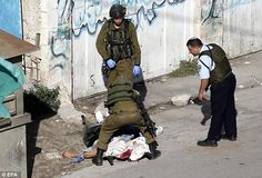 Police said the 23-year-old Palestinian stabbed the soldier in the head, wounding him lightly, at a checkpoint and then attempted to stab another security officer before forces opened fire and killed him