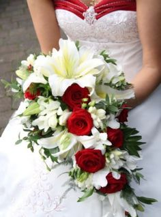 A cascading bouquet of red and white. White lilies, red roses, asparagus ferns, white dendrobiums and white freesias in this traditional bouquet. Bouquet En Cascade, Cascading Wedding Bouquets, Red Bouquet Wedding, Bride Bouquets, Red Wedding, Wedding Flowers, Wedding Colors, Wedding Ideas, Rose Bouquet