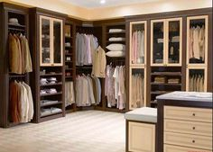 Imagen de http://10color.com/wp-content/uploads/Modern-Walk-In-Closet-With-Custom-Hardwood-Wardrobe-Closet-With-Brown-And-White-Painted-Also-Open-Shelves-Plus-Clothing-Hanger-As-Space-Saving-Designs.jpg.