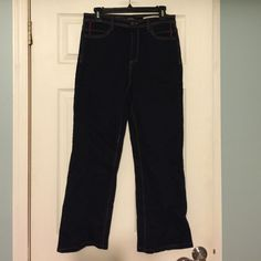 """NYDJ Embellished Pocket Jeans Super dark wash with fun bright contrast stitching and embellishments on the pockets. Immaculate condition minus one circular object on left pocket. Barely noticeable due to design. Inseam approximately 28"""" with 9"""" leg opening. Labeled a size 6 but would also fit an 8. NYDJ Jeans Flare & Wide Leg"""