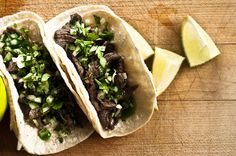 CARNE ASADA TACOS (for 12) ...    1 pound flat iron steak, sliced.  MARINADE: juice of 1 lime.  1/4 C olive oil.  1/4 C minced cilantro.  1-2 chilies, minced (to taste).  1 T minced garlic.  2 tsp sugar.  1/2 tsp coriander seed, crushed.  1/4 tsp ground cumin.  S + P.  1 tablespoon pureed kiwi.  GARNISH: minced cilantro.  finely diced onion.  your favourite hot sauce.  limes.