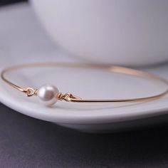 Gold Bangle Bracelet ~ Mother's Day Jewelry by georgiedesigns.  You could make a bunch of these with different stones or colored pearls and were multiple bracelets together