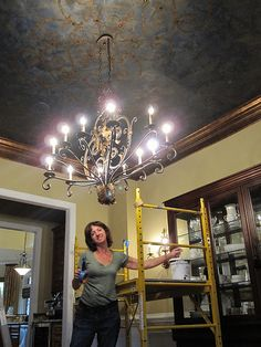 Faux painted ceiling with subtle ironwork motif, accented with upholstery nails