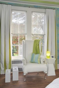 Use a contrast fabric inside your #boxpleat #draperies for a pop of color. This is a great way to incorporate an additional color into the room in small doses. #pleatedpanels #windowtreatment #designtrends