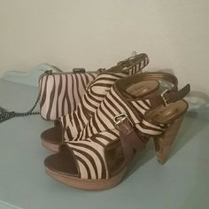 Nine West heels with matching bag Hot, Hot, Hot.  Like new.  Shoes worn once.  Paper still in the bag.  These are calf hair and pics do not do them justice.   These are fabulous in person! 4 in heel.  3 in with platform bag is 9 1/2 x 4 x 2 1/2 Nine West Shoes Platforms