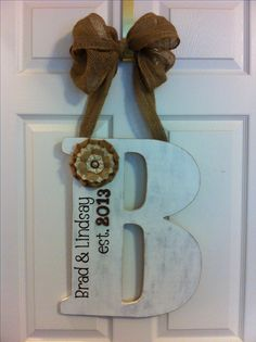 Wedding gift....what a great idea...but what's holding that letter to the ribbon ?